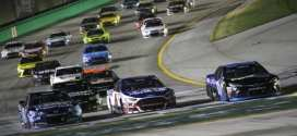 Pack racing in the NASCAR Quaker State 400 at Kentucky Speedway.