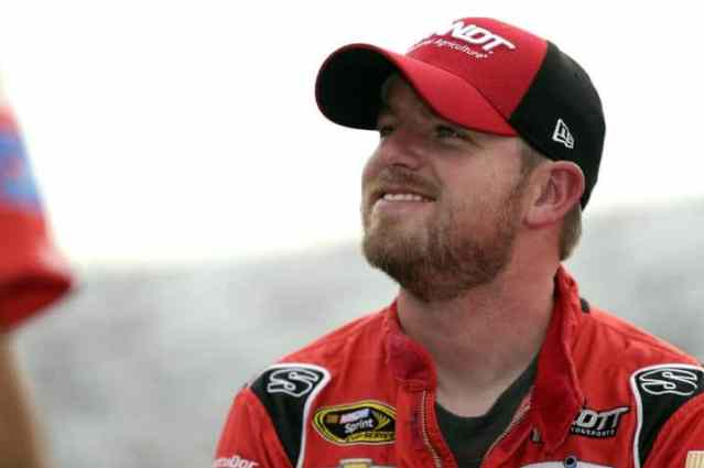 Justin Allgaier, driver of the No. 51 Brandy Chevrolet, in the garage at New Hampshire Motor Speedway