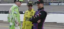 Kyle Busch, Matt Kenseth and Denny Hamlin compare notes before the Pure Michigan 400 at Michigan International Speedway