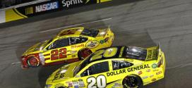 Joey Logano and Matt Kenneth battle for position during the Federated Auto Parts 400 at Richmond International Raceway