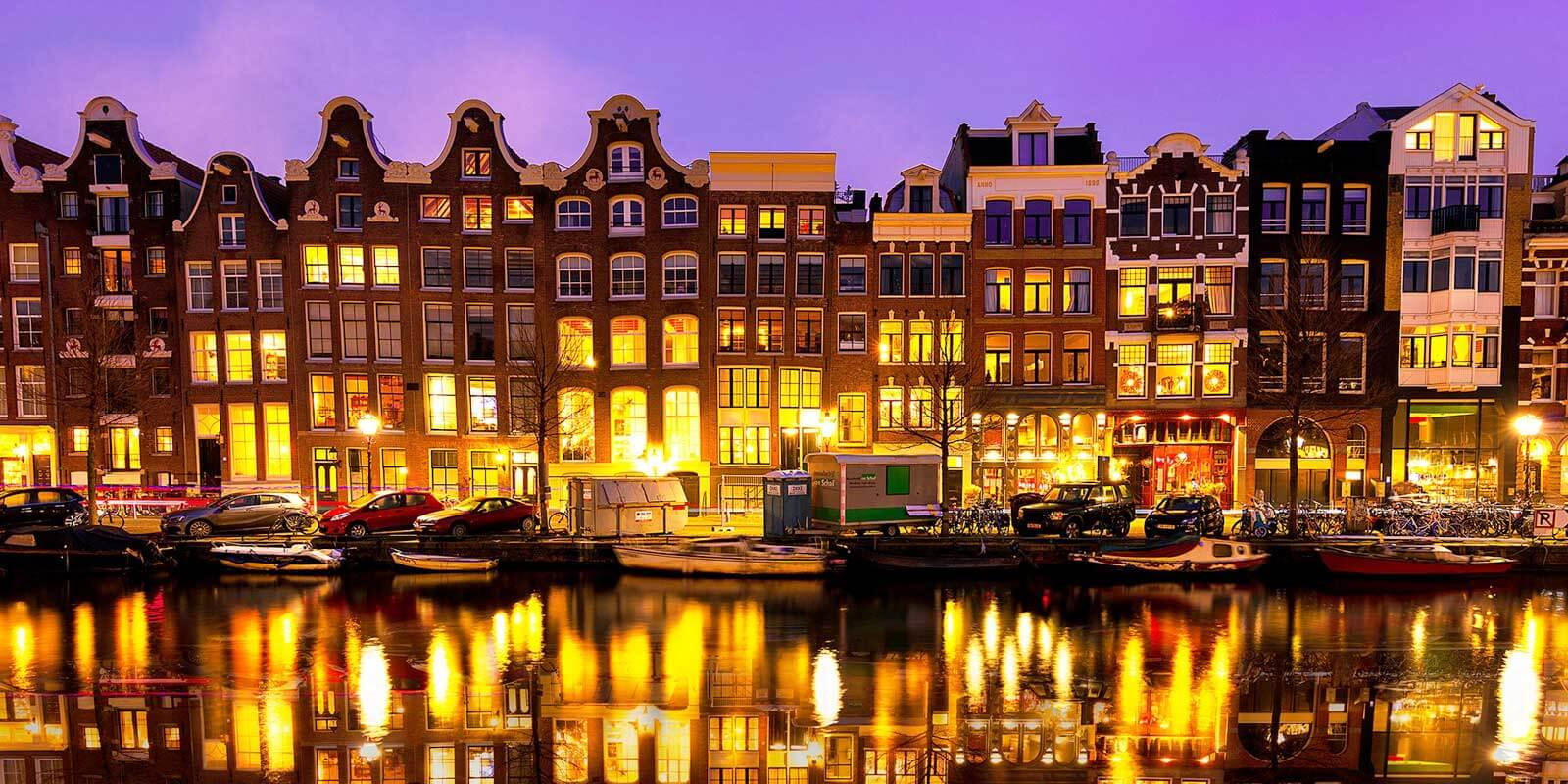 Stroll along the beautiful canals of Amsterdam in the Netherlands.
