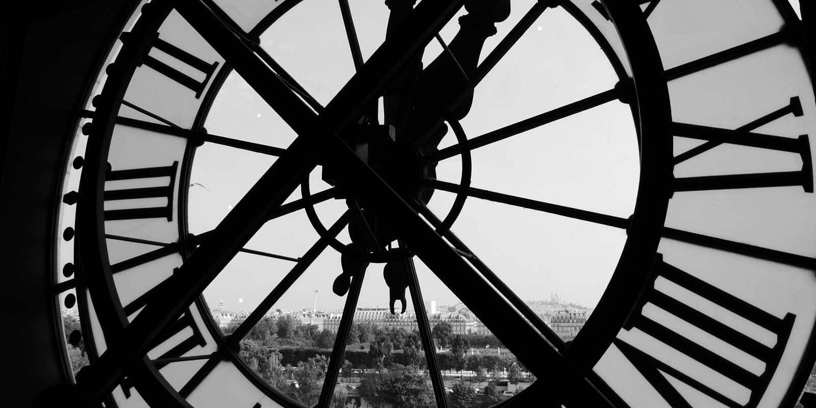 Closeup of the giant clock-slash-window from inside Musée d'Orsay in Paris, France.