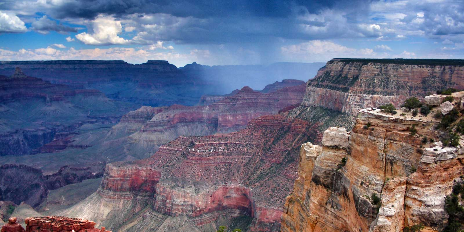 Close up of the Grand Canyon with dark and cloudy skies