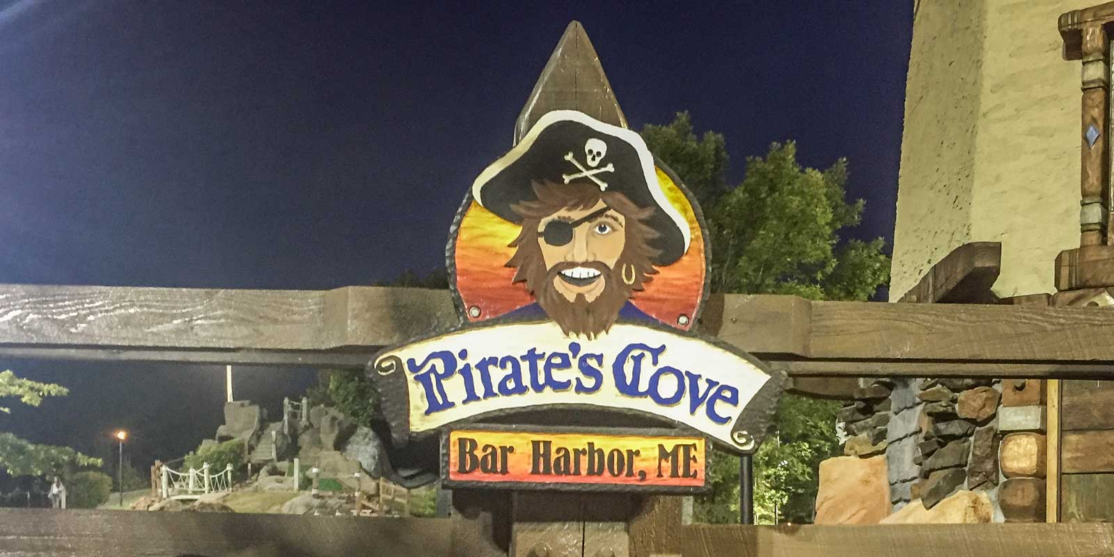 Closeup of a sign for Pirate's Cove Adventure Golf in Bar Harbor, ME.