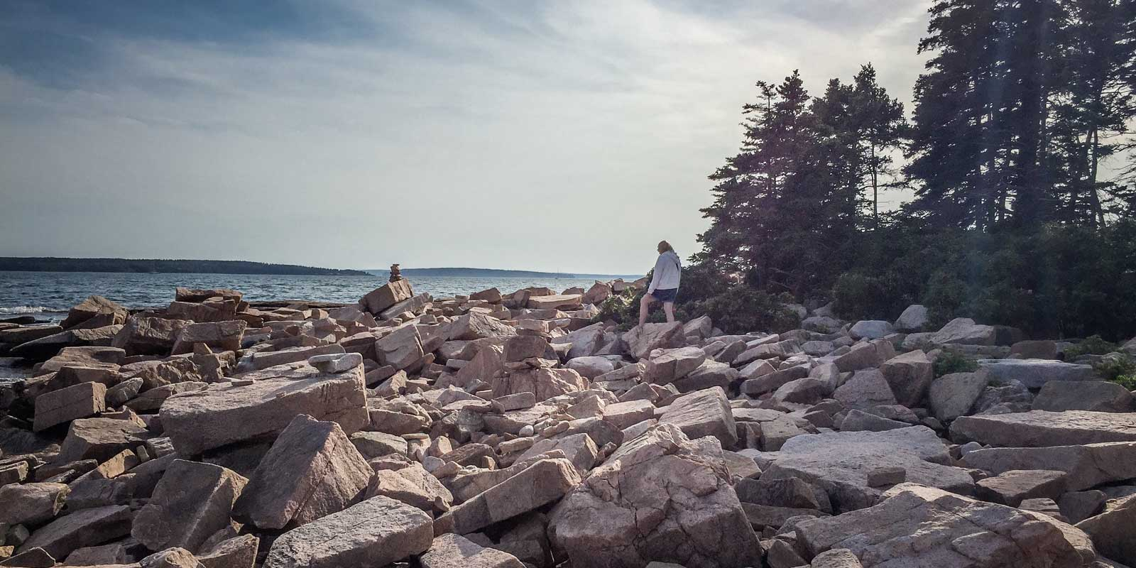 Landscape view of the rocky coastline at the end point of the Wonderland Trail in Southwest Harbor, Acadia National Park.