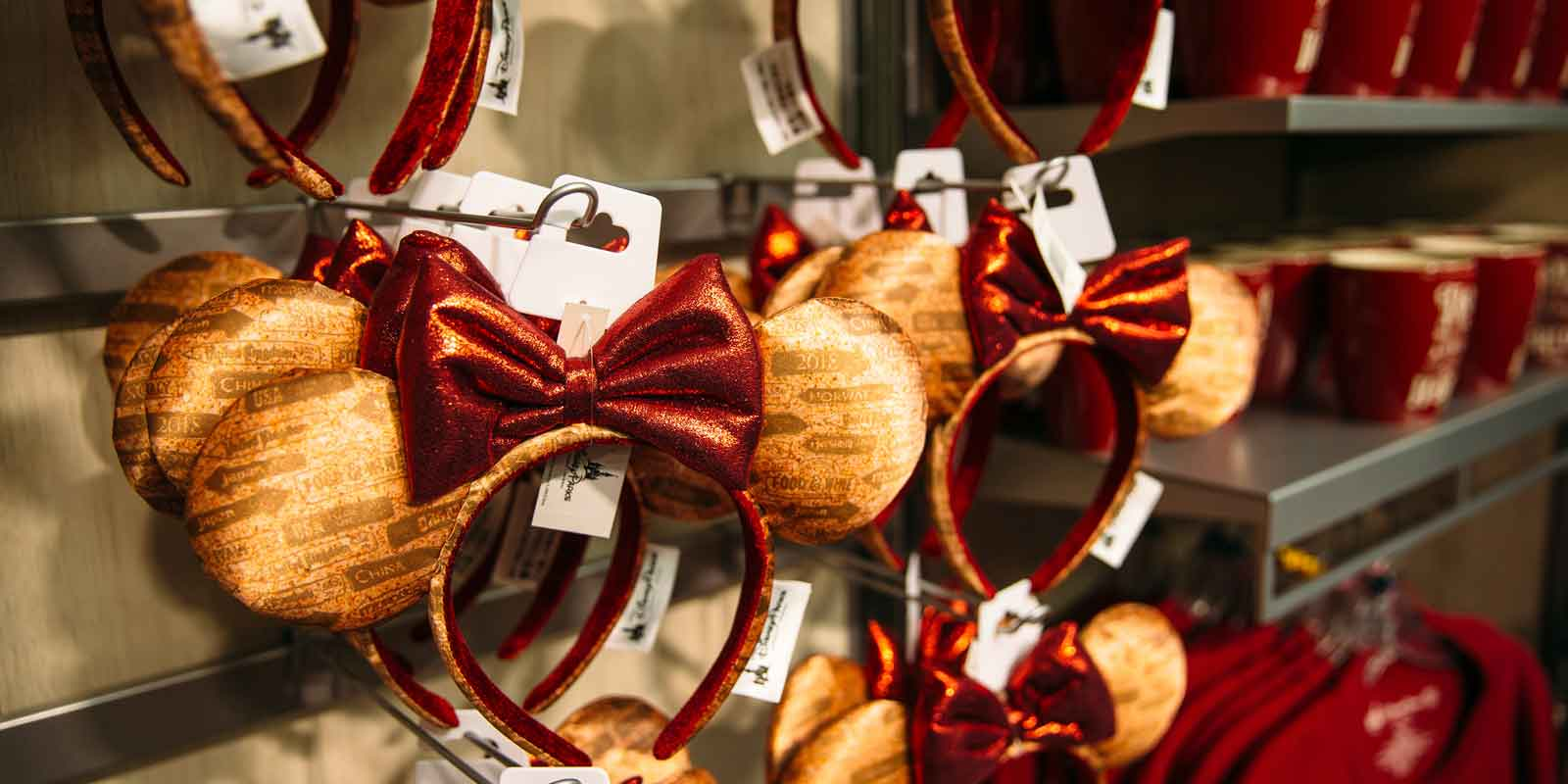 Closeup of rows of Minnie Mouse ears, mugs, and other Epcot Food & Wine Festival merchandise