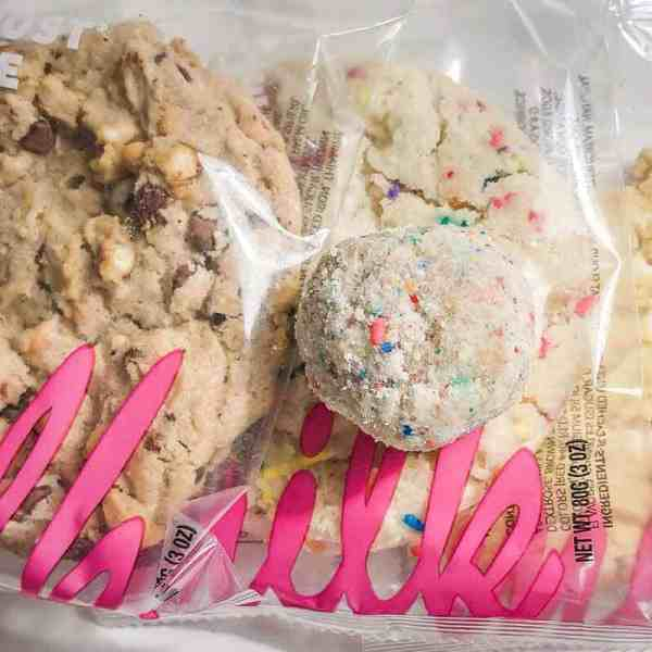 Three prepackaged cookies from Milk, with a birthday truffle on top.