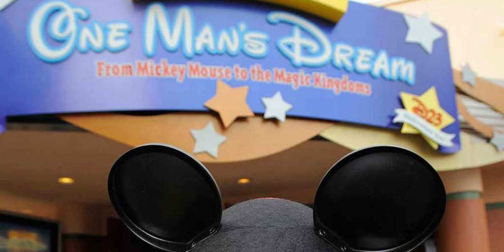 Photograph of the sign for One Man's Dream with a Mickey Mouse hat underneath.