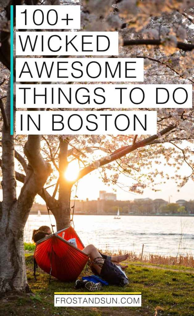 """Portrait view of the Charles River Esplanade at sunset with a couple in a red hammock strung between 2 flowering cherry blossom trees. Overlying text reads """"100+ Wicked Awesome Things to Do in Boston."""""""