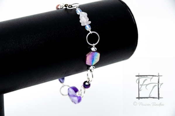 lavender silver plate bracelet with rose quartz, snowflake quartz, mother of pearl, and shell.