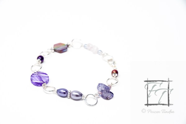 avender silver plate bracelet with rose quartz, snowflake quartz, mother of pearl, and shell.