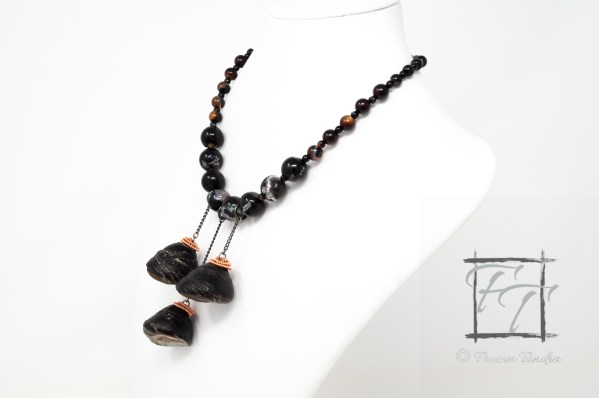 rocky intertidal zone agate necklace with black turban snails