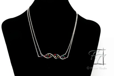 double-strand silver plate necklace featuring a double helix DNA strand hand-wrapped with wire and jewel-tone Czech fire-polished glass beads.