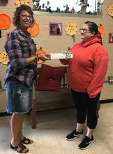 Samantha Archer Driggs who was Thursday's winner also from Greene County Developmental Services receiving her space gray iPad from Sherri Tredway, Development Director