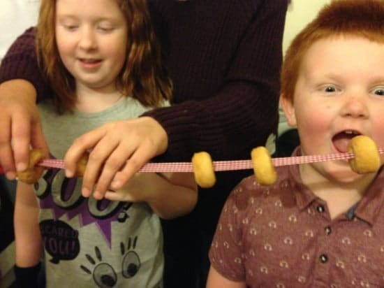 A 'Who can eat the most mini doughnuts threaded on to a ribbon' competition.