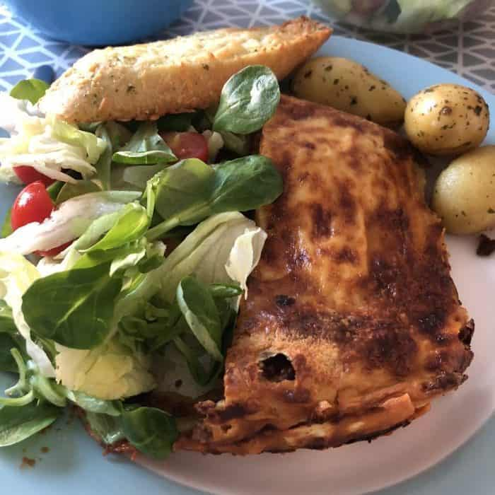 Lasagne, salad and garlic bread