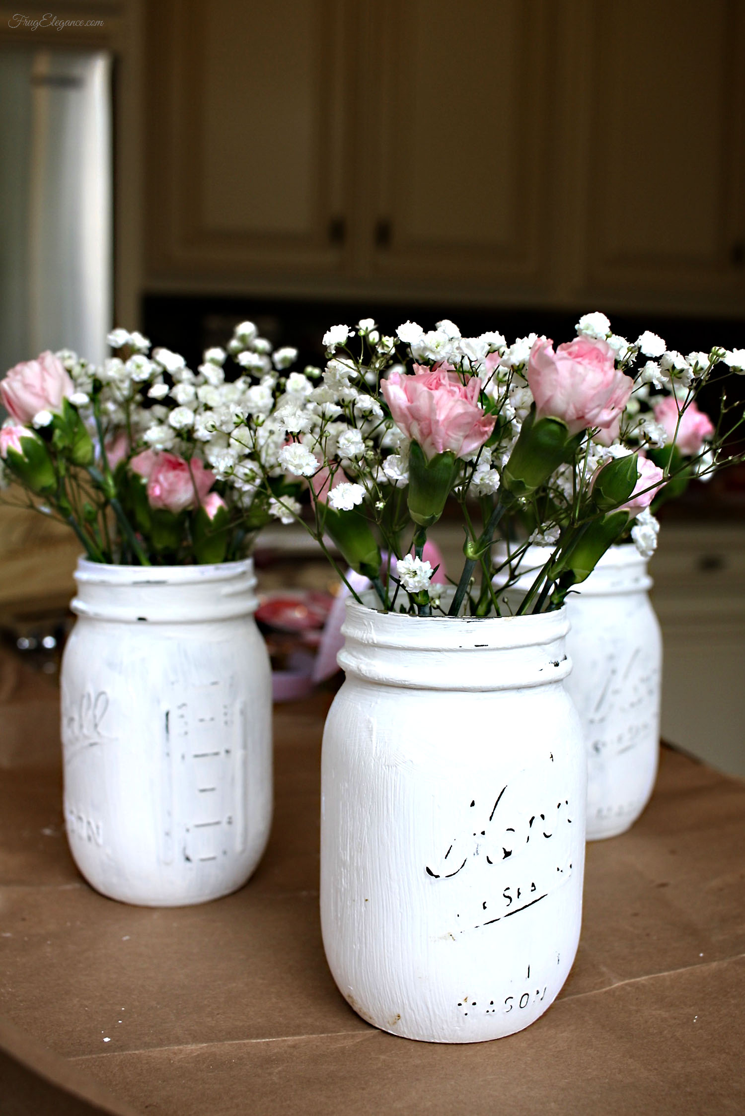 Valentines mason jar vases frugelegance we painted mason jars to use for a party but continue to use them for family gatherings and seasonal decor too now for our valentines decor reviewsmspy