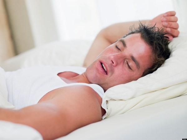 B3K34X Man lying in bed sleeping