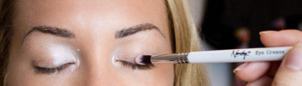 Picture of eyeshadow brush applying eyeshadow to eye