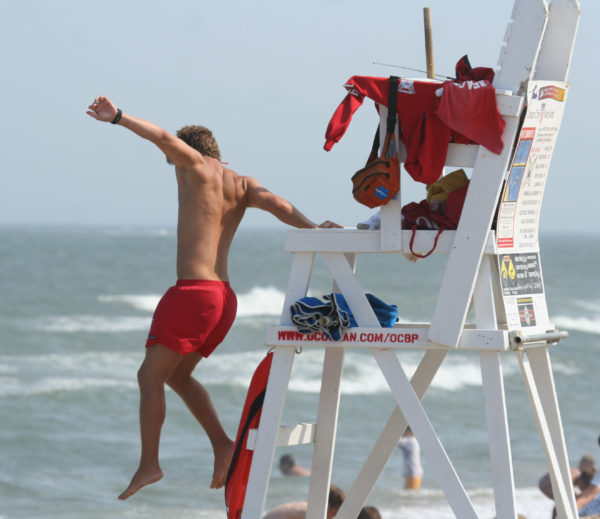 Lifeguard jumping into action