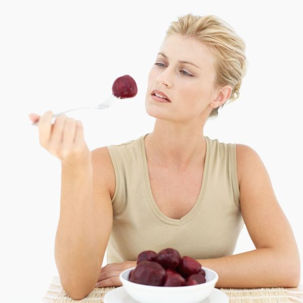 Woman-holding-beetroot-on-a-fork