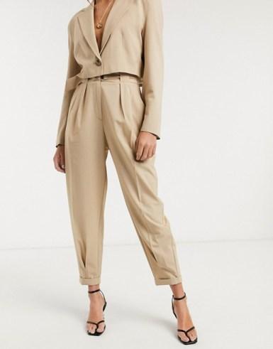 Bershka slouchy tailored trouser in beige £25.99