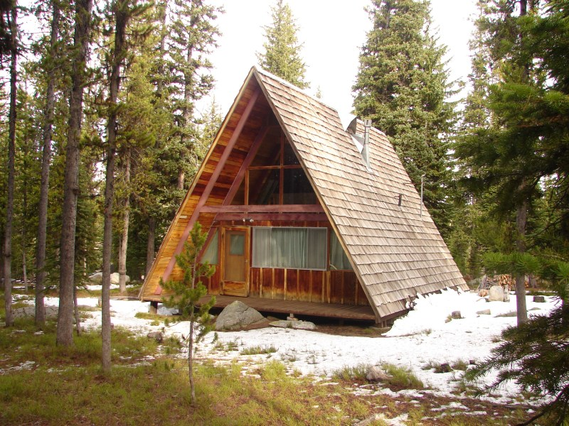Forest Service   Passes Wooden A frame cabin the the forest at Anthony Lake