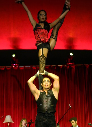 Acrobats Becca Feller and Miguel Balderrama, with Cosa Nostra Strings