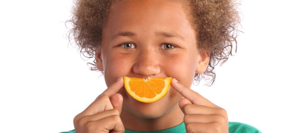 Boy with Orange Slice Smile