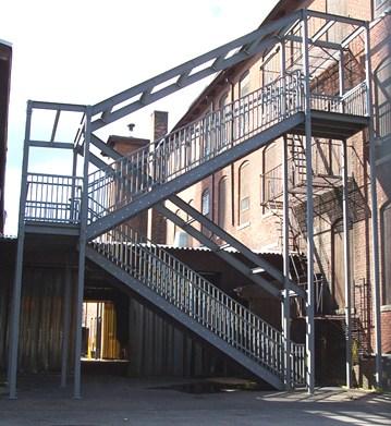 Ibc Prefab Steel Stairways | External Metal Fire Escape Stairs | Metal Railings | Stock Photo | Stair Railing | External Spiral Staircase | Fire Safety
