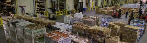 A factory building with boxes of produce
