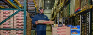 Man carrying strawberries in boxes