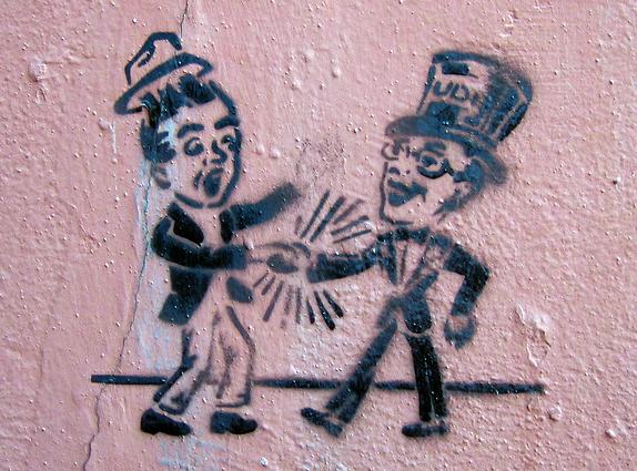 cartoon of a crushing handshake.