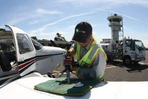 Man refuels charter plane with Avgas.