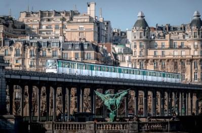 Climate friendly Paris Metro Line 6 MP73 crosses the Seine near Pont Bir-Hakeim