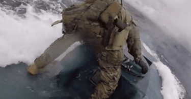 Video Coast Guardsman Hopped Onto a Moving Submarine