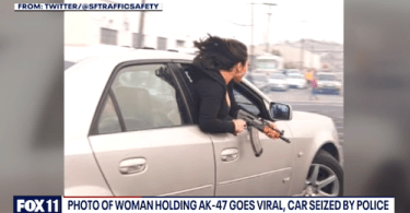 Woman allegedly holding assault rifle