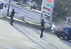 Police Shootout with Man Sitting in Backseat of Police Car Caught on Camera