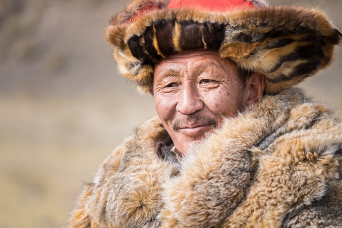 Portrait of a Kazakh eagle hunter. Happy and proud.