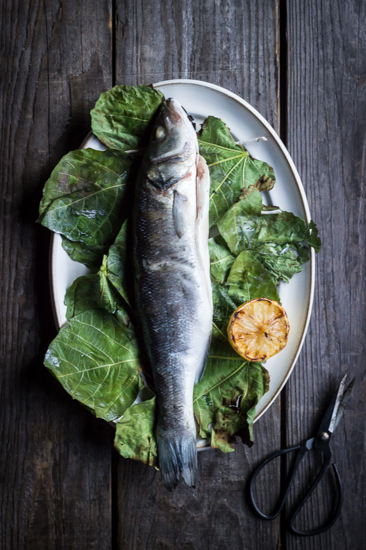 fig leaf wrapped grilled fish