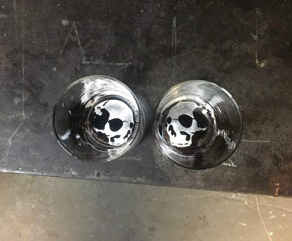 two Skull Tumblers on a steel tablel