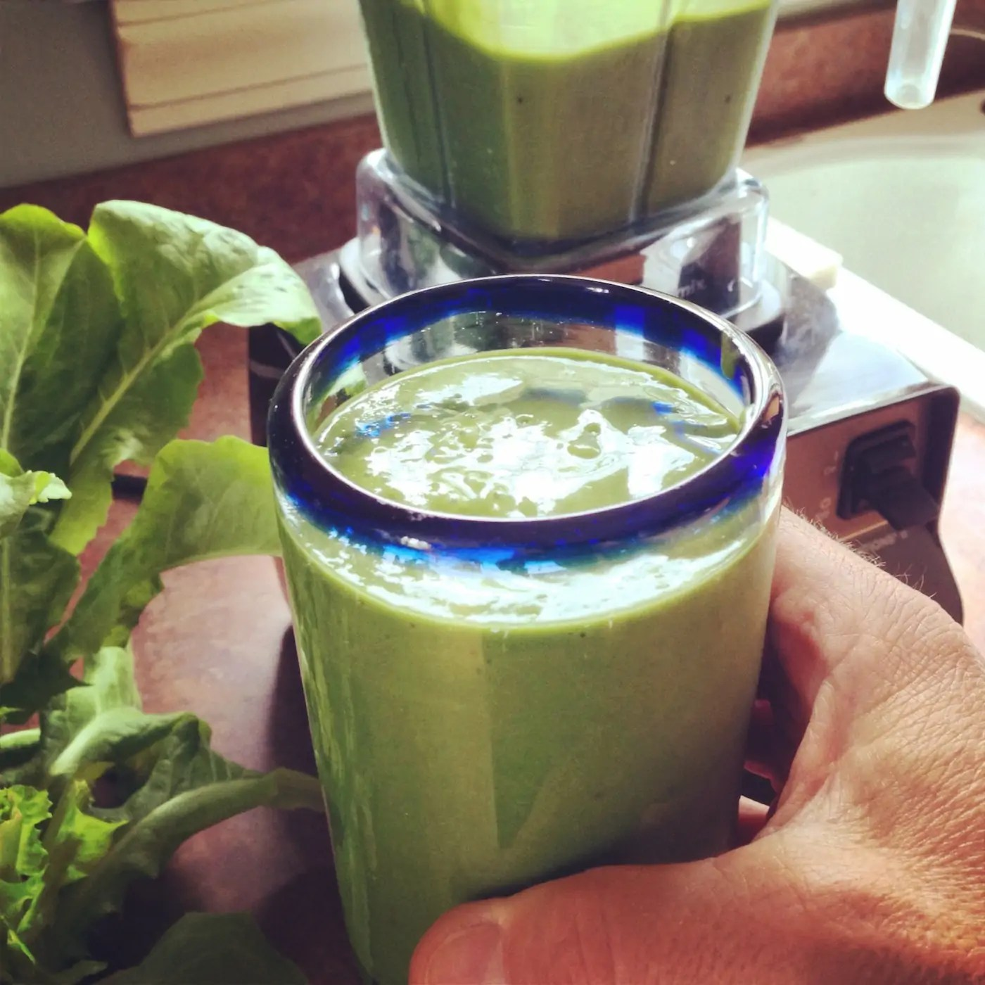 Glass filled with green smoothie.
