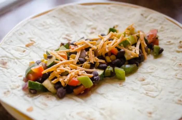 Filling for the veggie enchiladas on the tortilla