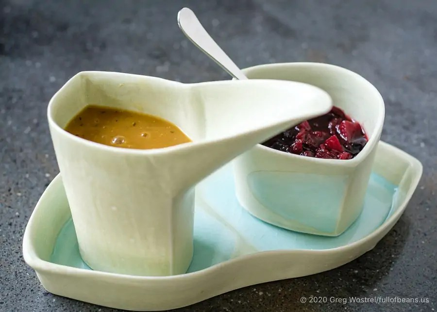 Guilt-free vegan gravy and cranberry chutney in a serving set