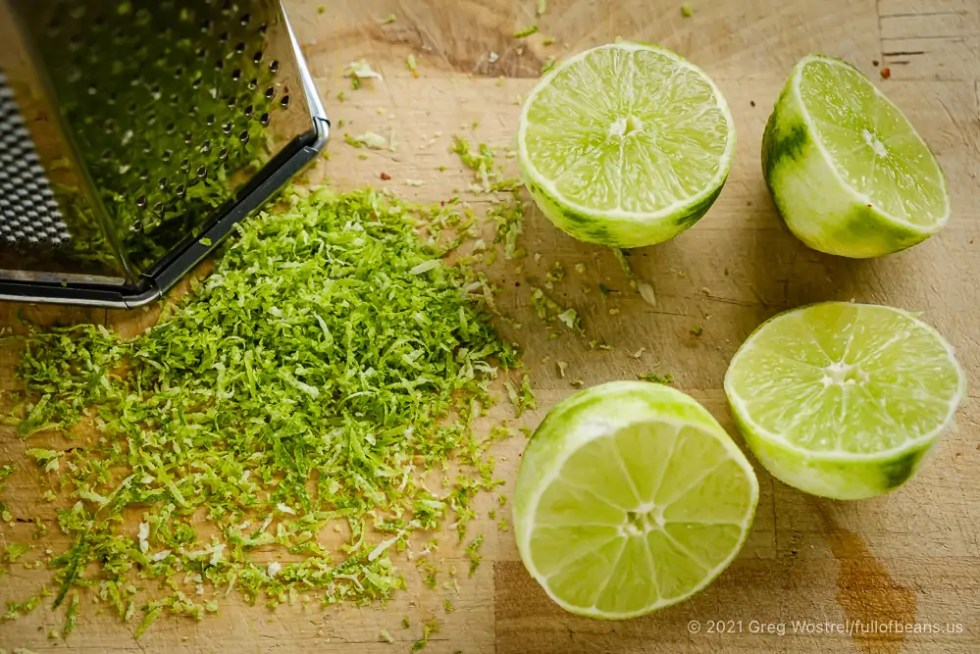 Fresh limes, lime zest, and a grater