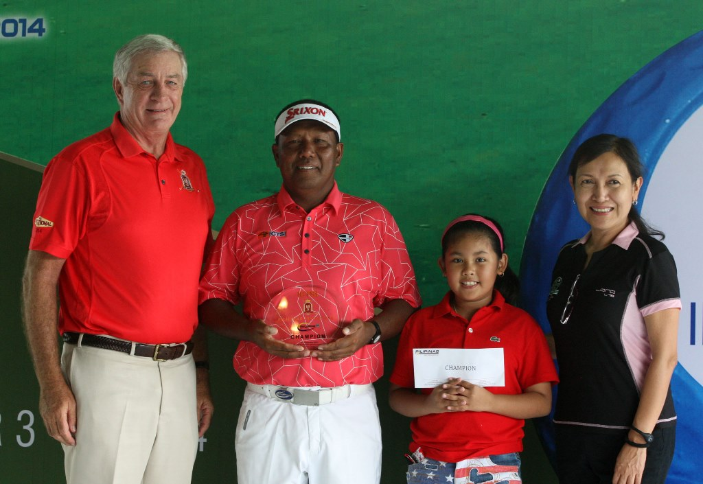 Tony Lascuña (second from left) shows his trophy while daughter Shanryl Antonette holds his prize as they pose with Manila Southwoods general manager Mark Watson (left) and ICTSI Public Relations head Narlene Soriano after ruling the P3.5 million ICTSI Pilipinas Invitational at Southwoods' Masters course in Carmona, Cavite over the weekend.
