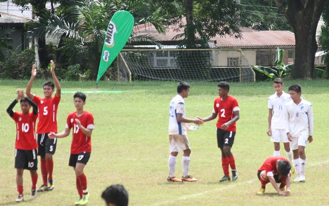 Team NCR's (San Beda Rizal)  John William Abraham, a former Little Azkals member, shakes the hand of a booter from Paref Springdale after their match.