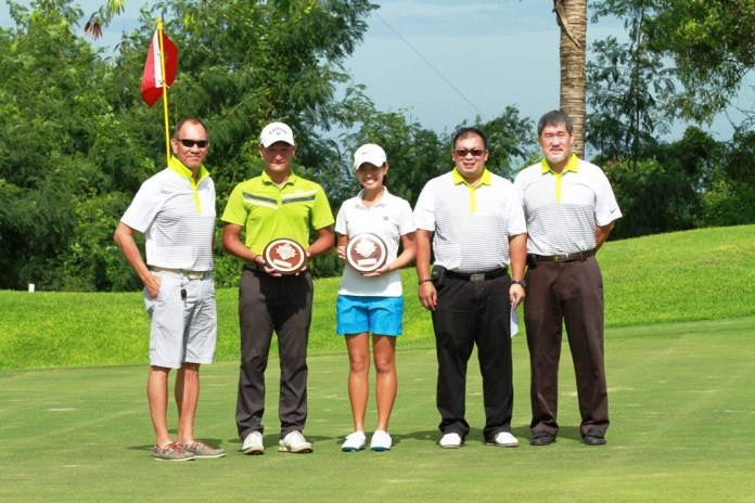 Gen Nagai and LK Go pose with committee members on the green of the 18th after topping their respective groups.  They are with (from left) Victor Gocela, Rodien Paca, and Ramon Sebastian.