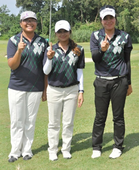 Members of the Team Philippines, from left, individual champion Miya Legaspi, Princess Superal and Pauline del Rosario, flash the No. 1 sign after dominating the field to capture the Santi Cup crown in the 54th South East Asian Amateur Golf Team Championship, also known as the Putra Cup, in Brunei Thursday.