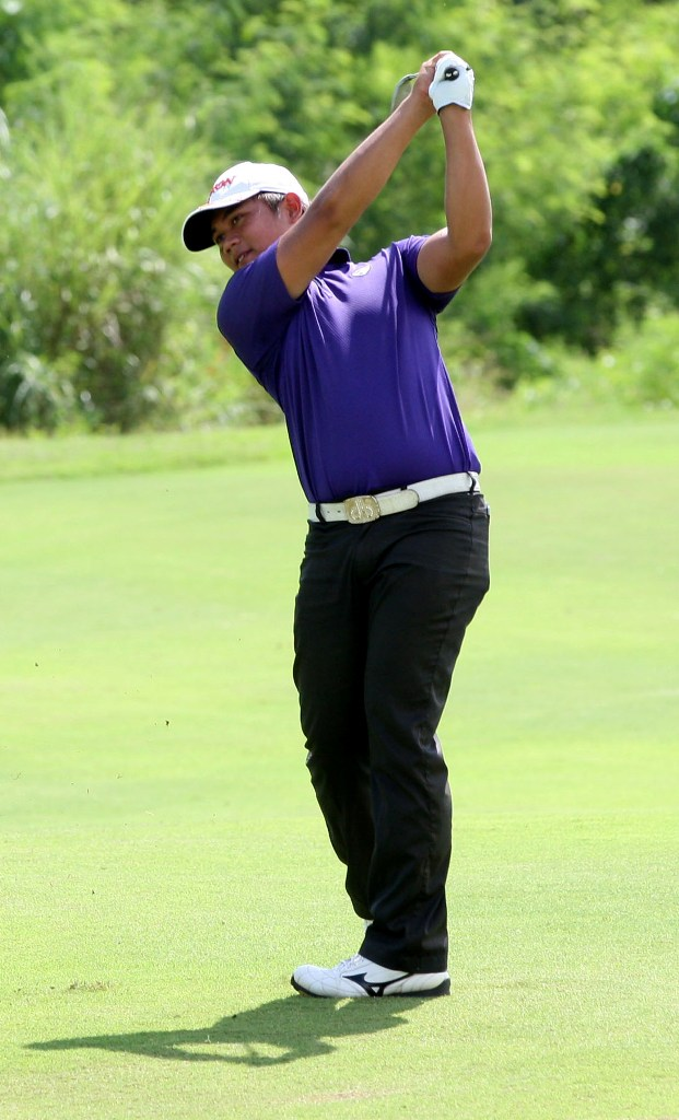 Clyde Mondilla hits his approach shot on No. 10 during Monday's pro-am tournament at Southlinks.